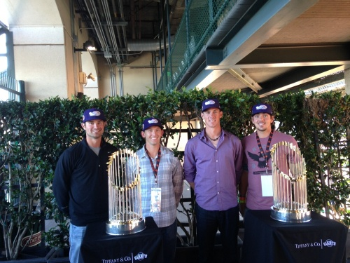 The Dash's four All-Stars pose with San Francisco's 2010 and 2012 World Series trophies (from left to right: Jeremy Farrell, Chris Curley, Chris Bassitt and Chris Beck).