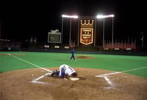 George Brett kissed home plate at Kauffman Stadium after the last home game of his career. (Photo: Cliff Schiappa, Associated Press)